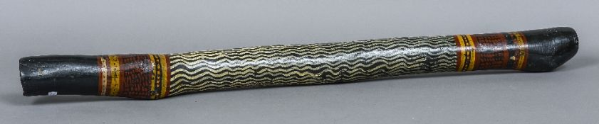 An Aboriginal didgeridoo Of typical form, with painted decoration. 113 cm long.