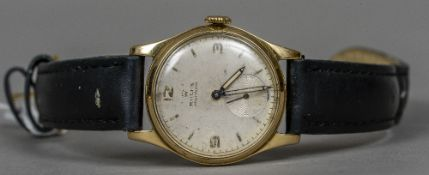 A gold Rolex Precision gentleman's wristwatch The silvered dial with Arabic numerals and batons and