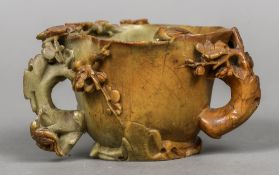 A 19th century Chinese carved soapstone libation cup Of organic form,
