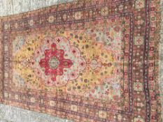 A Middle Eastern wood rug The desert yellow field enclosing a central medallion with pendant