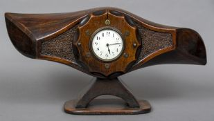 A mantle clock formed from a World War I propeller hub The white enamelled dial with Arabic