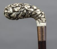 A 19th century Continental gold mounted carved ivory parasol/umbrella handle Profusely worked with