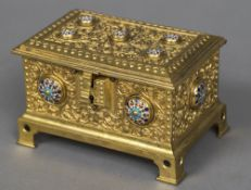 A Continental gilt metal cast casket The hinged cover and body with applied champleve roundels and