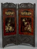 A late 19th century Japanese ebonised and lacquered two fold screen The interior decorated with