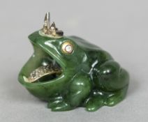 A Russian diamond set carved spinach jade group Worked as a frog prince. 5.5 cm wide.