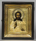 A yellow metal clad painted icon worked as Jesus Christ Housed in a glazed box frame.