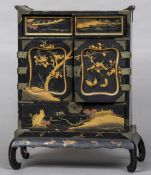 A late 19th/early 20th century Japanese lacquered table cabinet Of typical architectural form with