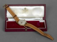 A 9 ct gold cased Garrard gentleman's wristwatch The plain dial with batons and Arabic numerals and