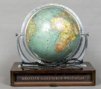 An early/mid 20th century Columbus Aardglobe Mounted on a walnut plinth base,