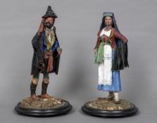 A pair of late 19th/early 20th century North Italian papier mache figures One a gentleman,