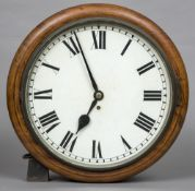 A Victorian mahogany cased fusee dial clock The white dial with Roman numerals. 43 cm diameter.