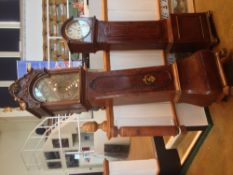 An 18th century Dutch walnut and burr walnut longcase clock The painted dial with silvered chapter