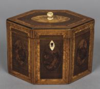 A parquetry inlaid tea caddy Of hexagonal section with hinged cover and lidded interior.