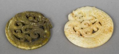 Two Chinese carved hardstone pendants Each formed as a scrolling dragon. The largest 7 cm diameter.