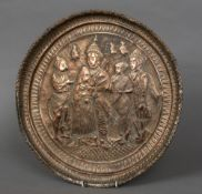 An early Indian copper charger Of dished circular form depicting Rama and Hanuman with various