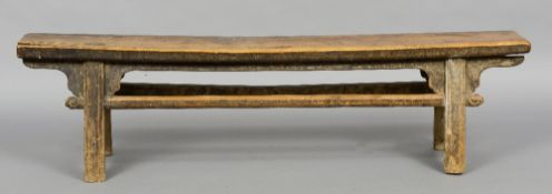 An 18th/19th century Chinese hardwood bench The moulded splayed legs with shaped brackets and