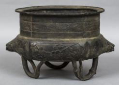 A large Chinese bronze twin handled censor The body with Pon tree and bamboo panels,