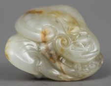A Chinese carved russet jade group Worked with Lingzhi. 4 cm wide.
