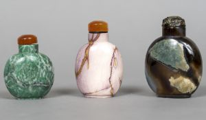 Three Chinese hardstone snuff bottles and stoppers The largest 8 cm high.