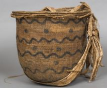 A 19th century American Indian woven basket With painted decoration depicting stylised snakes,