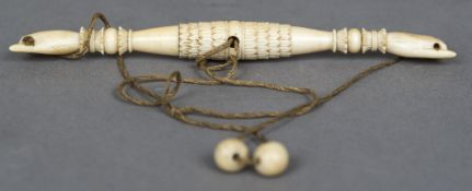 An unusual 19th century carved ivory implement Formed as twin collared hands, one side unscrewing,