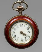 A Victorian enamel decorated silver fob watch The white enamel dial with Arabic numerals. 2.