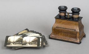 A late 19th/early 20th century walnut cased stereoscopic viewer Of typical hand held form;