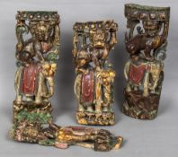 Four 19th century Chinese painted carved wooden uprights Each formed as a dog-of-fo astride and
