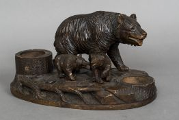 A 19th century Black Forest carved wood desk stand Modelled as a bear and her cubs,