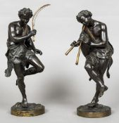 A pair of 19th century patinated and painted bronze models of Bacchic figures Each modelled wearing