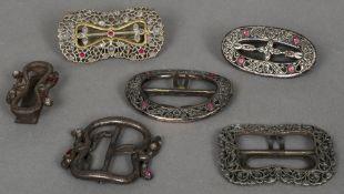Four Eastern gem set buckles Pierced and foliate cast;