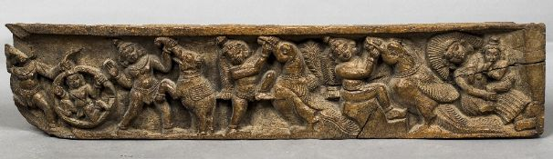 An 18th century Indian carved wood panel Worked with incidents in the childhood of Shiva.