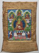An Eastern painted and needlework Thanka Typically worked, framed. 53 x 80 cm.