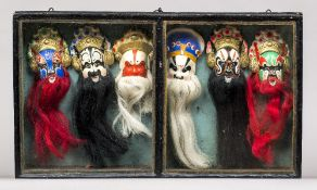 An early 20th century ebonised case The hinged glazed top containing various Chinese masks. 49.