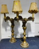 A pair of 19th century carved giltwood table lamps Each formed as an eagle holding twin branches,
