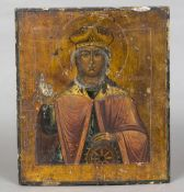 An antique Russian icon Typically painted on panel with a religious view of a saint and with text.