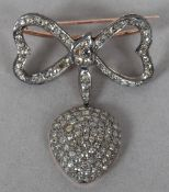 A yellow metal and silver diamond set brooch,