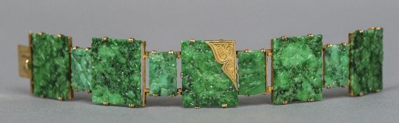 A French gold, jade set bracelet With eagle's head guarantee mark,