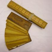 A Far Eastern antique prayer book The decorated wooden boards containing a quantity of prayers on