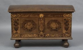 A 19th century Dutch inlaid oak domed topped trunk The front with floral and bird filled marquetry