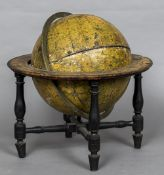 A 19th century Cary's New Terrestrial Globe Of typical form, mounted on a table top stand,