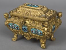 A Continental gilt metal cast casket The hinged cover and bombe body scroll cast and with inset
