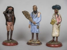 Three Indian Poona clay figures The largest 20.5 cm high.