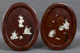 A pair of Japanese shibyama inlaid red lacquered panels Each of oval form inlaid with female