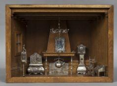 A quantity of Dutch silver miniature furniture with .