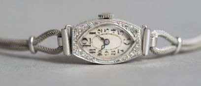 A Swiss Art Deco diamond set platinum cased lady's cocktail watch with 9 ct white gold strap The