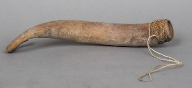 A New Guinea penis sheath Formed from a gourd. 31 cm long.