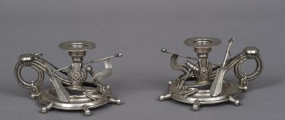 A pair of Continental silver chamber sticks,