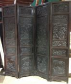 A 19th century Chinese carved hardwood four fold screen Well worked with figural panels,