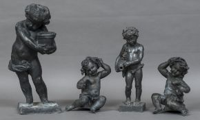 Four cast lead figures Two modelled as seated putti, the others standing holding vessels.